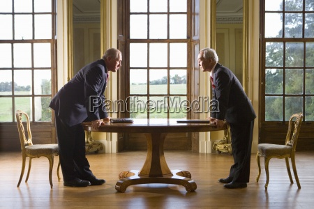 businessman and colleague looking at each