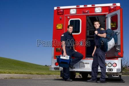 paramedic and colleague by open door