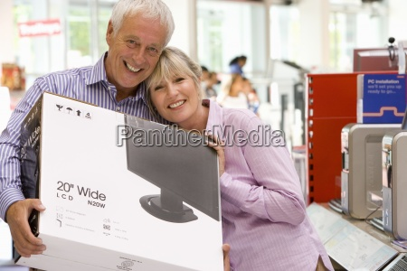 mature couple shopping man with computer