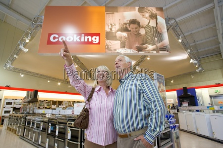mature couple shopping in appliance store