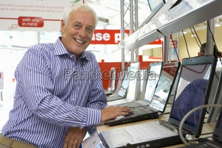 mature man shopping for laptop computer