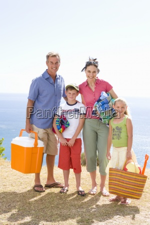 family of four with cooler towels