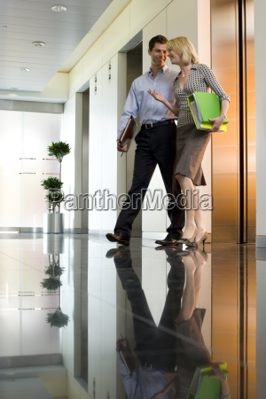 businessman and woman in conversation low