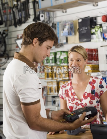 man using credit card reader in