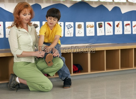 teacher tying boys 4 6 shoelace