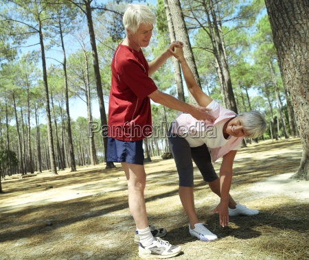 active senior couple in sportswear exercising