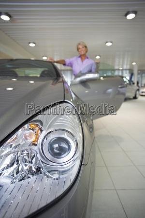 senior woman looking at new silver