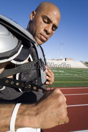 american football spieler einstellen schutzschulterpolster band