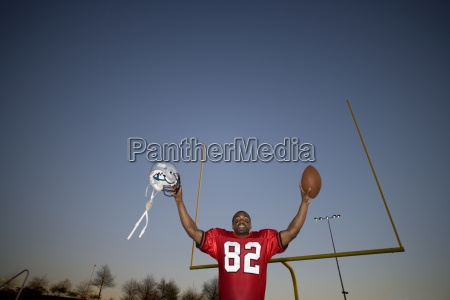 american football player in red football