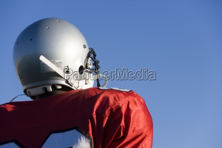 american football player wearing red football