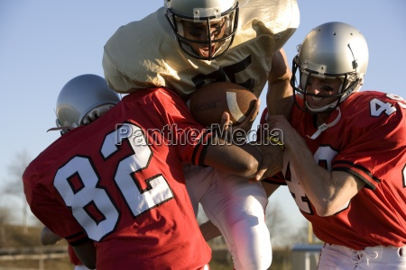 determined american football player running with