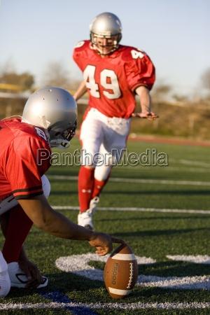 american football spieler der versucht field