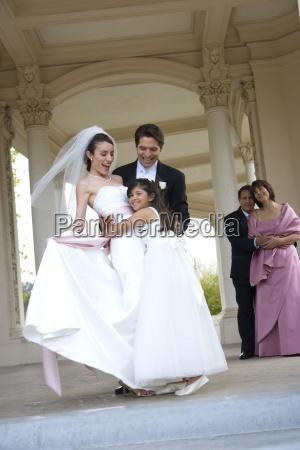 bridesmaid 8 10 embracing bride groom