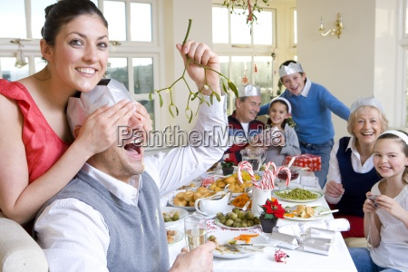 woman covering eyes of man with