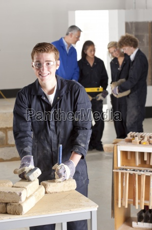 student with hammer and chisel in
