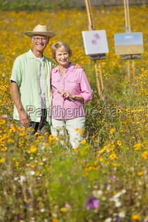portrait of smiling couple painting with