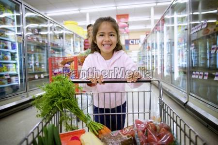 girl 4 6 shopping in supermarket