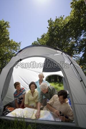 multi generational family sitting inside tent