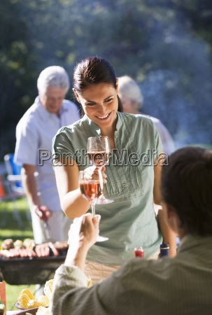 family having barbecue in summer garden