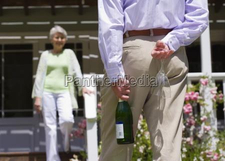 senior woman descending veranda steps focus