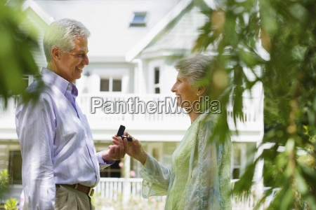 senior man proposing to senior woman