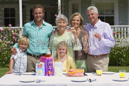 three generation family celebrating senior womanxe2x20acx2122s