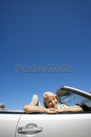 senior woman sitting in passenger seat