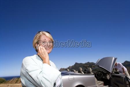 senior woman using mobile phone outdoors