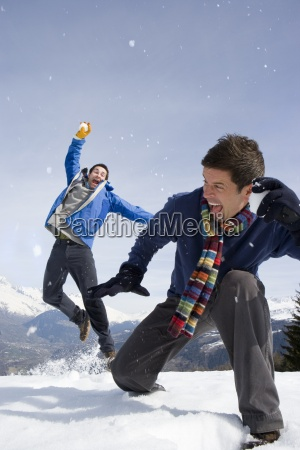 two young men having snow fight