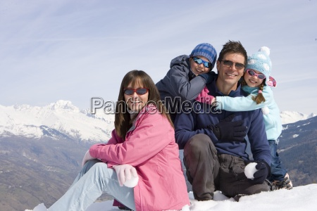 family of four sitting together in