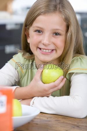 girl 6 8 holding up green