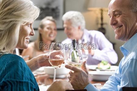 mature couple toasting wine glasses at