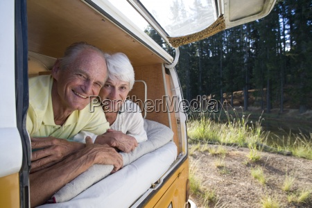 senior couple lying in back of