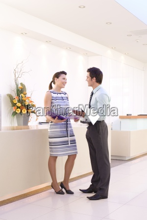 businessman and woman with paperwork by