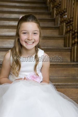 flower girl 10 12 on stairs
