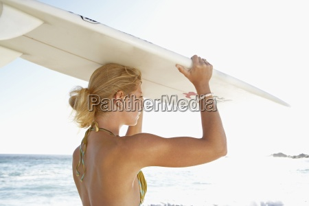 young woman standing on beach in