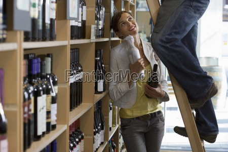 customer talking to shop owner in