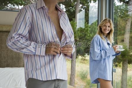couple relaxing in bedroom woman in