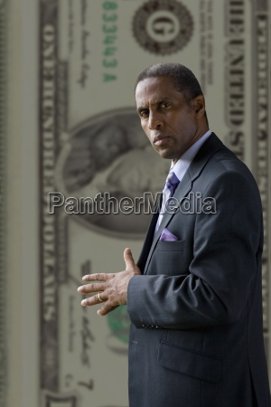 serious businessman standing in front of