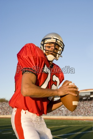 quarterback with football looking downfield