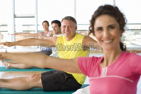 people taking exercise class smiling portrait