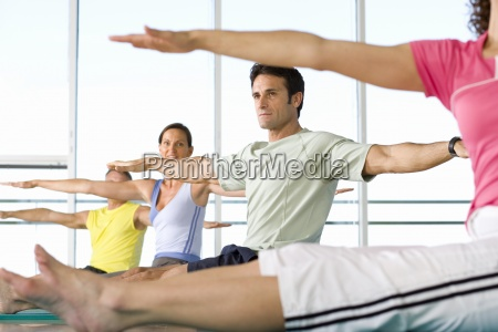 people taking exercise class low angle