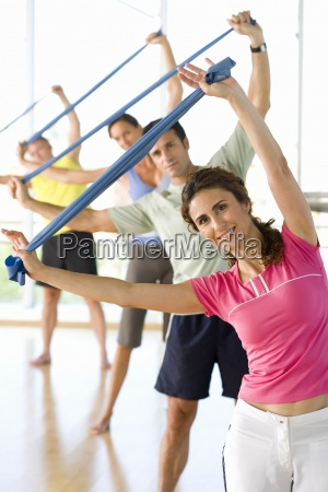 people taking exercise class with exercise