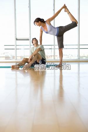 woman doing yoga in studio smiling