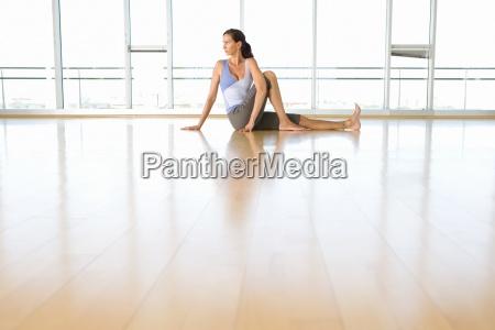 woman doing yoga in exercise studio