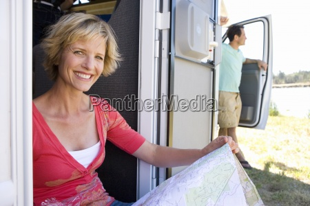 mature woman with map in back
