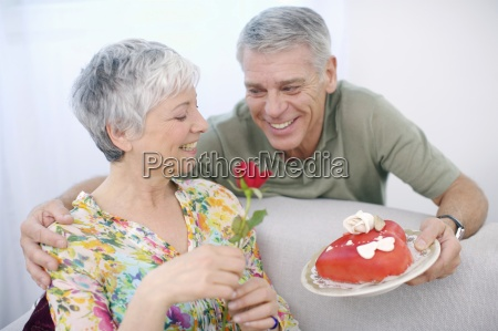 senior man romancing woman with valentine