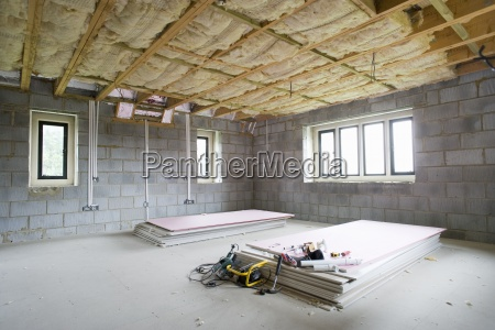 insulation and plywood in house under