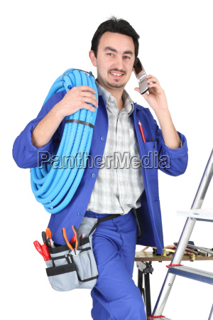 plumber with materials toolbox and cellphone