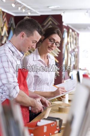 boss talking to craftsman working on